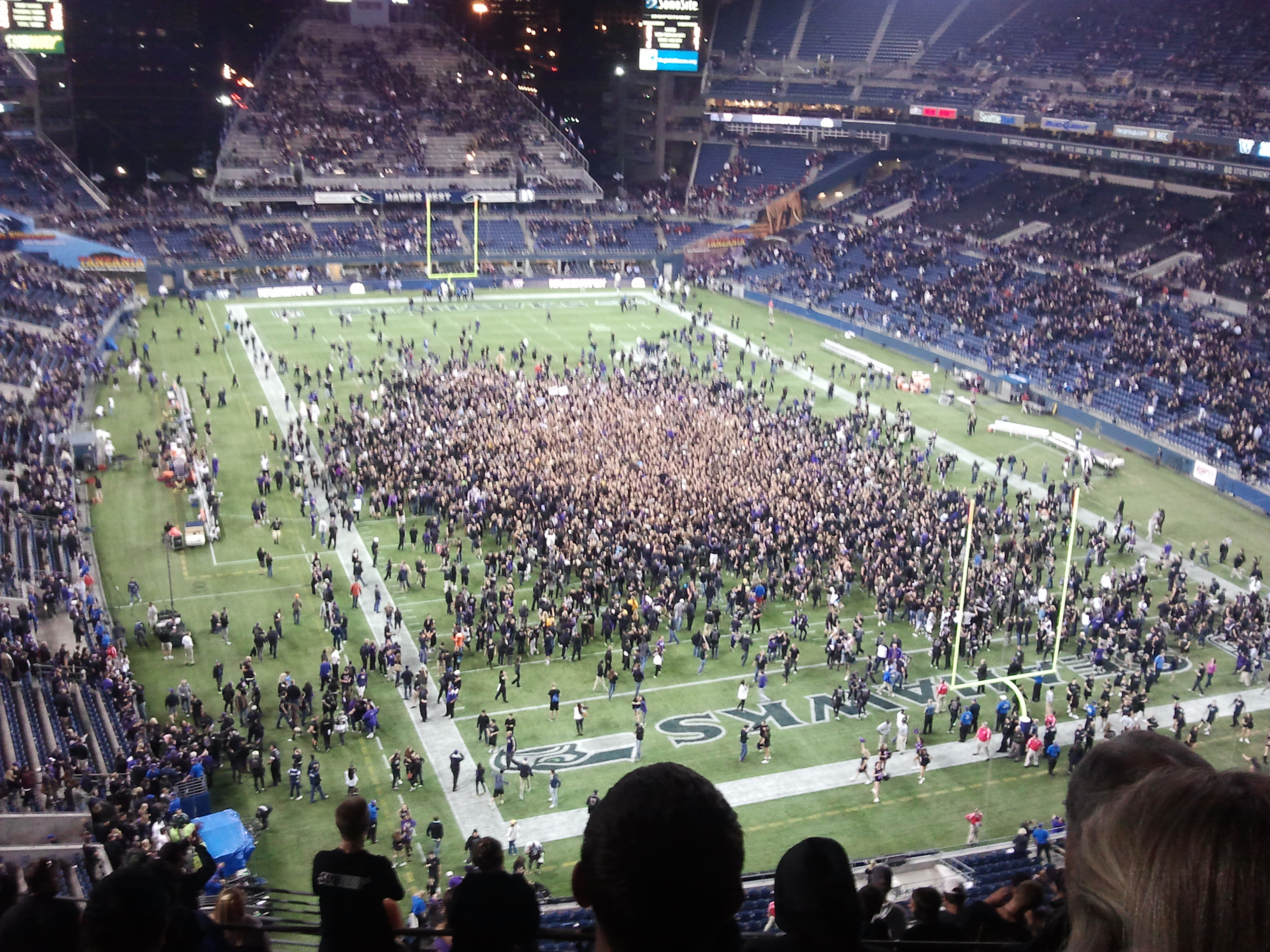 Husky fans storm the field after Thursday's upset of No. 8 Stanford.